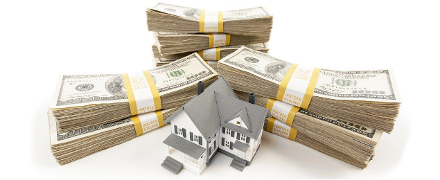 stacks-of-one-hundred-dollar-bills-with-small-house